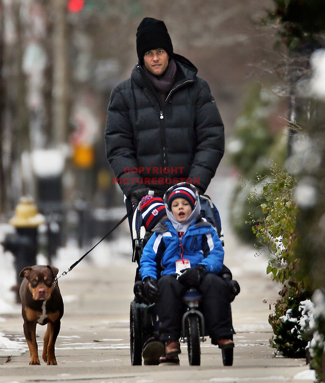 Tom Brady has a winter playmate with sons Benjamin and Jack Moynahan this New Years Eve morning in Boston.