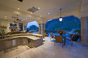 Sunken kitchen area of split level kitchen in Palm Springs home