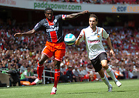 Photo: Tony Oudot.<br /> Paris Saint-Germain v Valencia. The Emirates Cup. 29/07/2007.<br /> Bernard Mendy of Paris St Germain beats Emiliano Moretti of Valencia to the ball