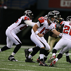 2007 October, 21: Falcons quarterback Joey Harrington (13) hands off to running back Warrick Dunn (28) during a 22-16 win by the New Orleans Saints over the Atlanta Falcons at the Louisiana Superdome in New Orleans, LA.