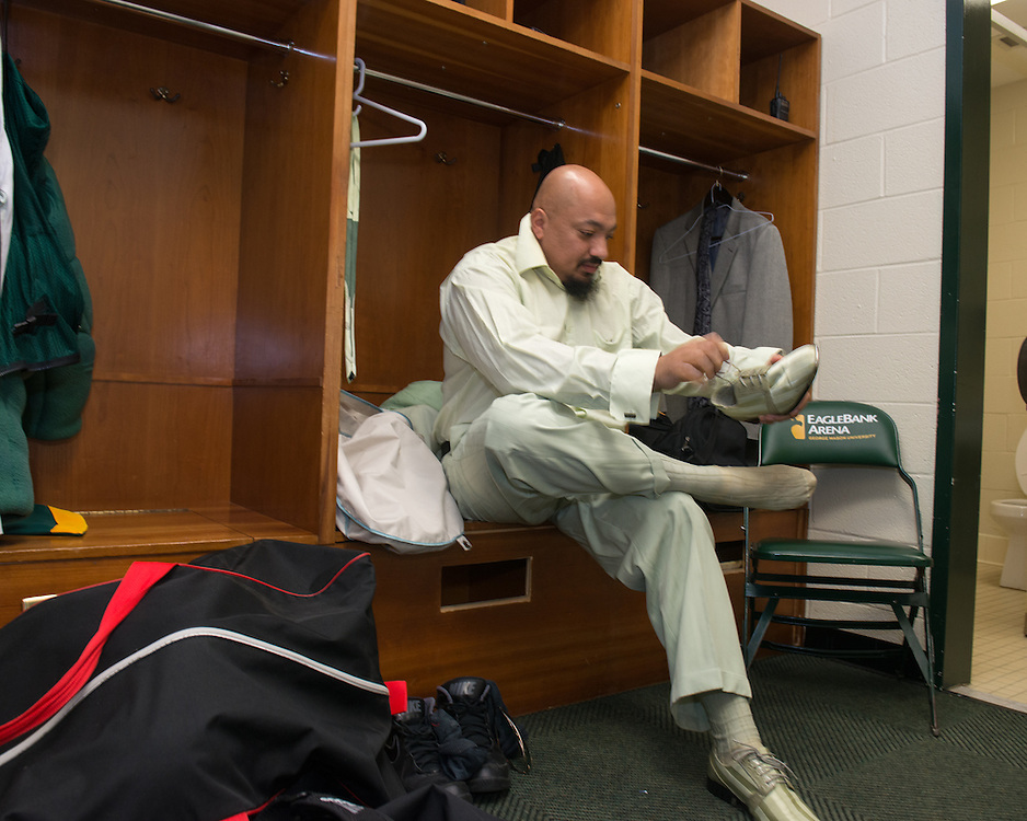 December 5, 2015 - Fairfax, VA - A day in the life of &quot;Doc Nix,&quot; aka Dr. Michael Nickens, the Director of the Athletic Bands for George Mason University. Here in the dressing room Doc Nix puts his ensemble on.<br /> <br /> Photo by Susana Raab