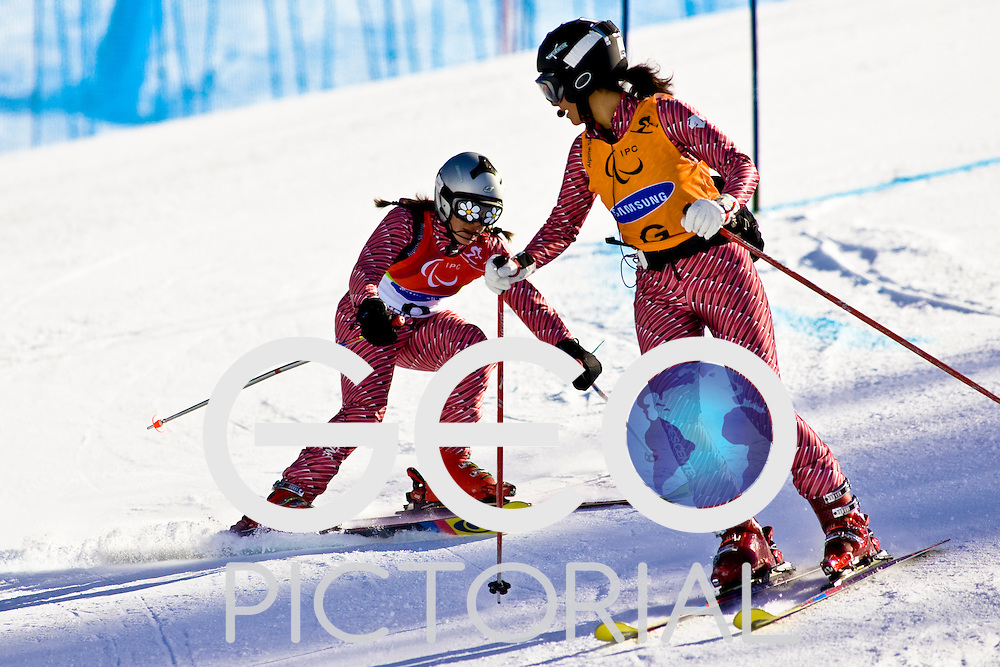 SESTRIERE COLLE, ITALY - MARCH 17th : Alba de Toro (B1) of Spain follows the shouts of her guide in the Womens Alpine Skiing Giant Slalom Visually Impaired competition on Day 7 of the 2006 Turin Winter Paralympic Games on March 17th, 2006 in Sestriere Borgata, Italy.