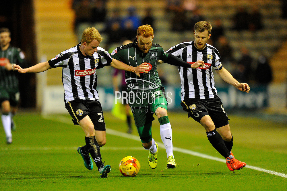 Ryan Taylor (19) of Plymouth Argyle is sandwiched between Josh Clackstone (23) of Notts County and Michael O'Connor (8) of Notts County while on an attack during the EFL Sky Bet League 2 match between Plymouth Argyle and Notts County at Home Park, Plymouth, England on 28 February 2017. Photo by Graham Hunt.