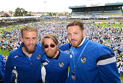 Bristol Rovers' Will Puddy,  Stuart Sinclair and Tom Parkes pose for a photo in front of the fans at the Memorial Stadium - Photo mandatory by-line: Dougie Allward/JMP - Mobile: 07966 386802 - 25/05/2015 - SPORT - Football - Bristol - Bristol Rovers Bus Tour