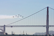 Blue Angels As Seen In Flight Passing In Front Of The Golden Gate Bridge