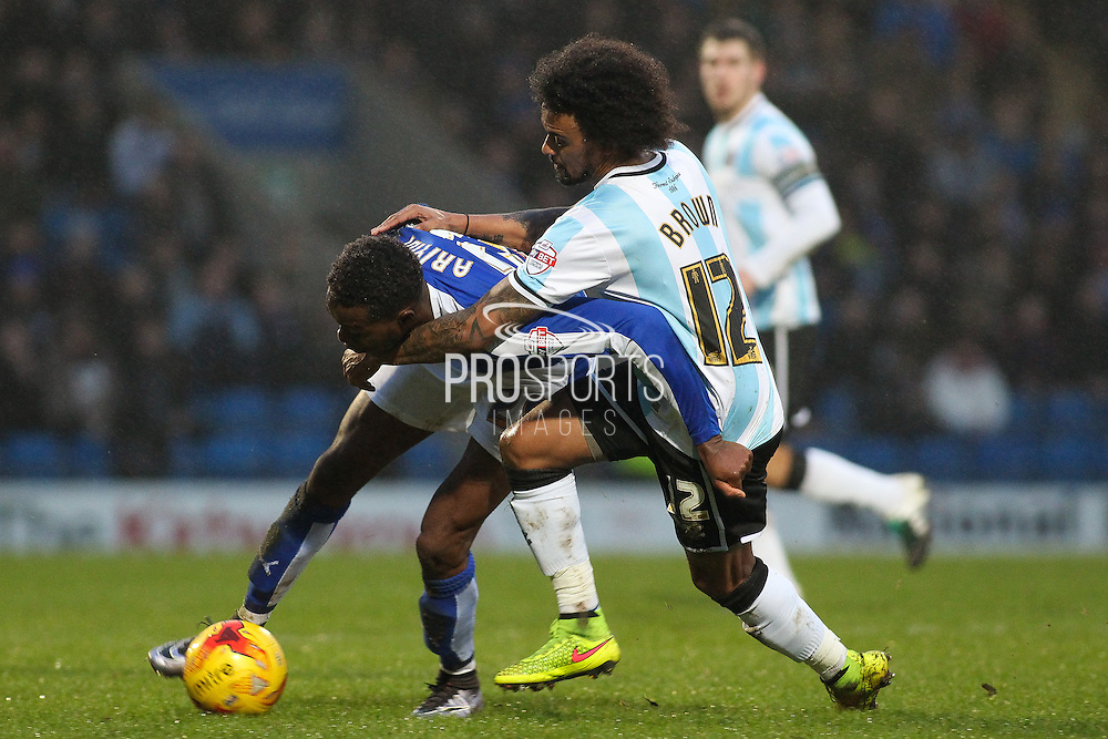 Shrewsbury Town FC midfielder Junior Brown pulls down Chesterfield FC midfielder Gboly Ariyibi during the Sky Bet League 1 match between Chesterfield and Shrewsbury Town at the Proact stadium, Chesterfield, England on 2 January 2016. Photo by Aaron Lupton.