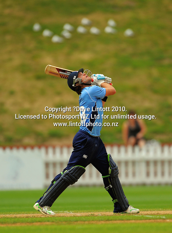 Auckland's Lou Vincent sends up a skyball, which was dropped in the swirling wind by Dewayne Bowden. One Day cricket - Wellington Firebirds v Auckland Aces at Allied Nationwide Finance Basin Reserve, Wellington on Wednesday, 2 February 2011. Photo: Dave Lintott / photosport.co.nz