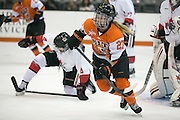 RIT's Jess Paton follows a puck during an exhibition game at RIT's Gene Polisseni Center on Monday, September 29, 2014.