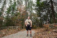 Thomas Hayes stands at an area of the trail where he cleaned out the brush surrounding the stone walls and added gravel for his Eagle Scout project at Jeff Marden Forest in Belmont.  (Karen Bobotas/for the Laconia Daily Sun)