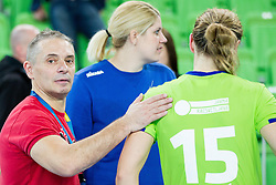 Tone Tiselj, head coach of Krim and Barbara Lazovic-Varlec #15 of RK Krim Mercator after winning the handball match between RK Krim Mercator (SLO) and  Metz Handball (FRA) in 4th Round of Women's Champions League on November 2, 2013 in Arena Stozice, Ljubljana, Slovenia. (Photo by Vid Ponikvar / Sportida)
