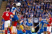 Shrewsbury Town defender Aristote Nsiala (22) clears  during the EFL Sky Bet League 1 Play Off second leg match between Shrewsbury Town and Charlton Athletic at Greenhous Meadow, Shrewsbury, England on 13 May 2018. Picture by Simon Davies.