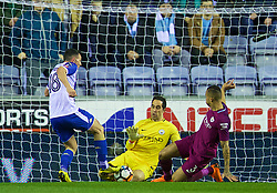 WIGAN, ENGLAND - Monday, February 19, 2018: Manchester City's goalkeeper Claudio Bravo saves at the feet of Wigan Athletic's Gary Roberts during the FA Cup 5th Round match between Wigan Athletic FC and Manchester City FC at the DW Stadium. (Pic by David Rawcliffe/Propaganda)