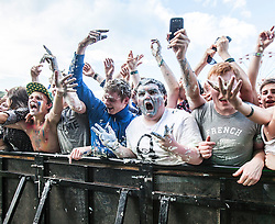 "Steve Aoki throws his cake into the crowd, playing the main stage, Saturday at Rockness 2013, the annual music festival which took place in Scotland at Clune Farm, Dores, on the banks of Loch Ness, near Inverness in the Scottish Highlands. The festival is known as ""the most beautiful festival in the world"" ."