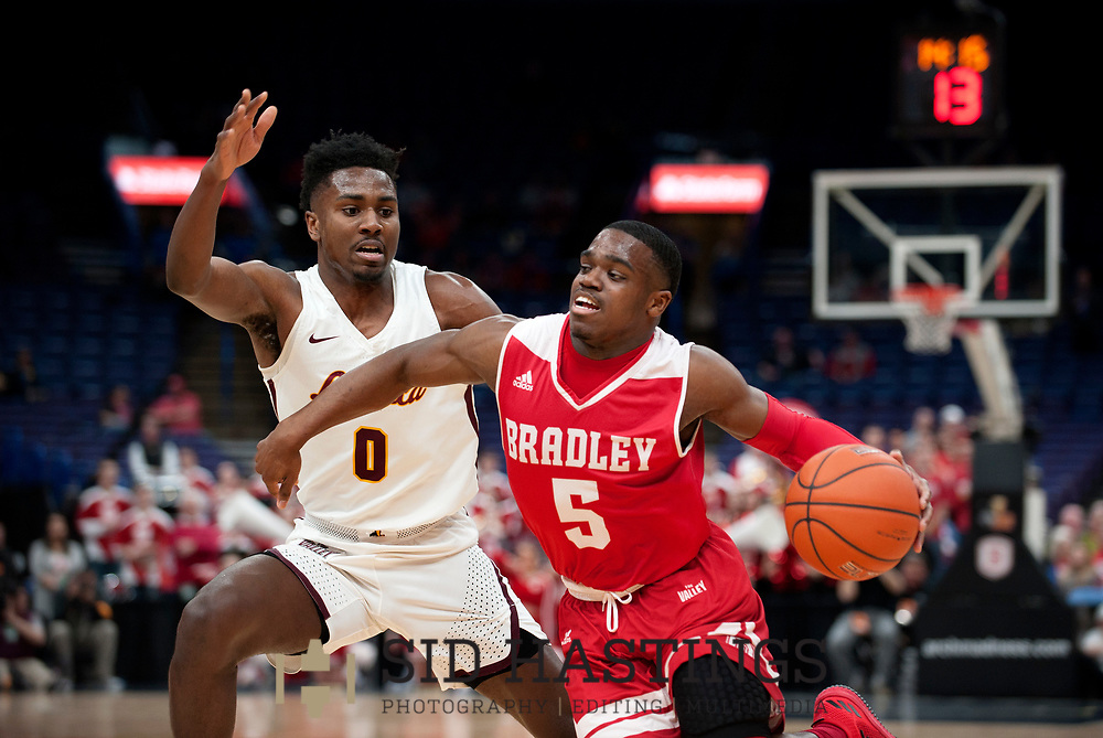 Loyola University Chicago basketball player Donte Ingram (0) defends against Bradley University's Darrell Brown (5) during the semifinals of the Missouri Valley Conference men's basketball tournament at Scottrade Center in St. Louis Saturday, March 3, 2018. LUC won, 62-54. Photo © copyright 2018 Sid Hastings.