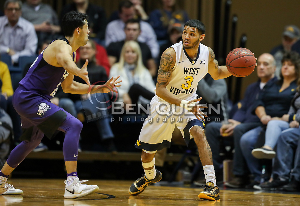 Feb 12, 2018; Morgantown, WV, USA; West Virginia Mountaineers guard James Bolden (3) passes the ball during the first half against the TCU Horned Frogs at WVU Coliseum. Mandatory Credit: Ben Queen-USA TODAY Sports
