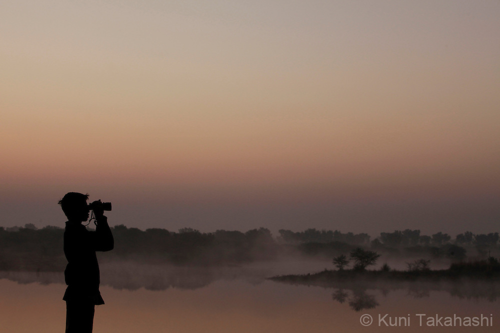 Bird watcher at Chhatra Sagar resort in Rajasthan, India on Dec 30, 2010.<br /> Photo by Kuni Takahashi