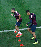 Alex Oxlade-Chamberlain of England trains with Chris Smalling (R) during the England training session at Arena Corinthians, Sao Paulo, Brazil, on the eve of their World Cup 2014 Group D match against Uruguay.<br /> Picture by Andrew Tobin/Focus Images Ltd +44 7710 761829<br /> 18/06/2014