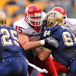 Oct 25, 2008; Heinz Field, Pennsylvania, United States; Rutgers defensive end Alex Silvestro (45) tries to fight past Pittsburgh offensive lineman Robb Houser (64) during the first quarter of Rutgers' 54-34 victory at Heinz Field.