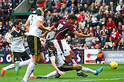 Paul Quinn makes a vital tackle from Osman Sows shot during the Ladbrokes Scottish Premiership match between Heart of Midlothian and Aberdeen at Tynecastle Stadium, Gorgie, Scotland on 20 September 2015. Photo by Craig McAllister.