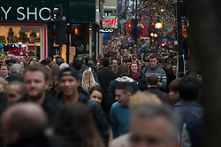 © Licensed to London News Pictures./14/2013. London, UK. Christmas shoppers walk on Oxford Street during the Christmas shopping season.Photo credit : Peter Kollanyi/LNP