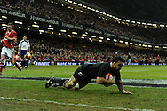 New Zealand's Liam Messam dives over to score  his sides 1st try.Dove Men autumn international series, Wales v New Zealand at the Millennium stadium in Cardiff , South Wales on Saturday 24th November 2012. pic by Andrew Orchard, Andrew Orchard sports photography,