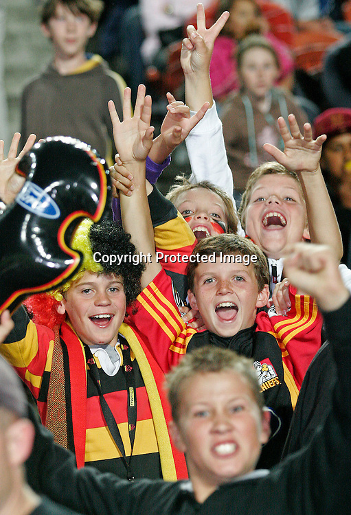 Young Chiefs fans enjoy their time at the Super 14 rugby union match between the Chiefs and the Crusaders at Waikato Stadium, Hamilton on Friday 10 March 2006. The Crusaders won the game 25-19. Photo: Andy Song/PHOTOSPORT