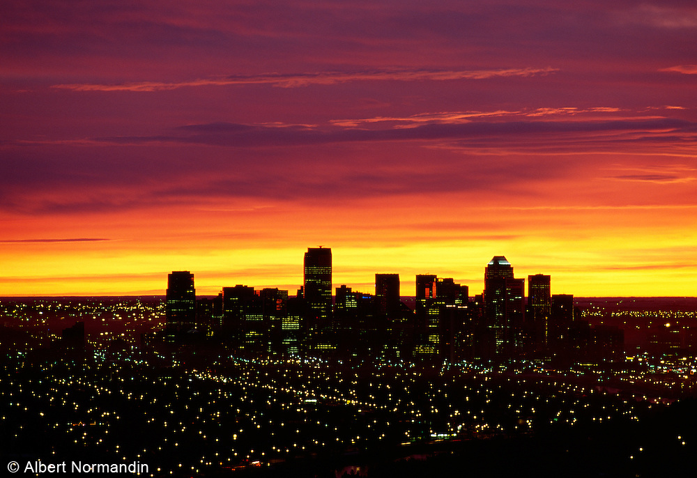 Red clouds at sunrise over Calgary, tight