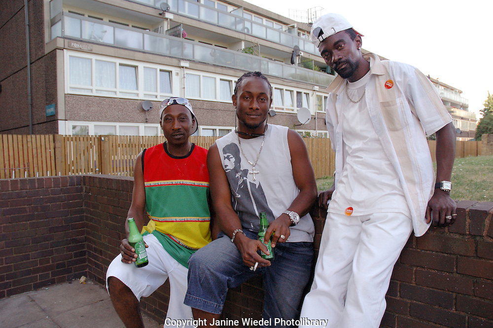 Group of West Indian lads hanging out and drinking on housing Estate in south London.