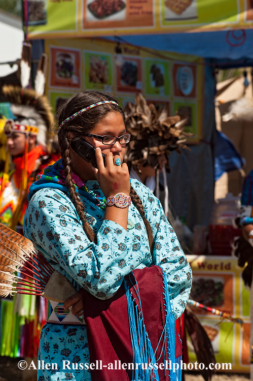 Traditional dancer, Crow Fair, powwow, talks on mobile phone, Montana.
