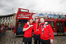 Greg Cunningham, Luke Ayling and Wade Elliott pose in front of the bus in Lloyds Amphitheatre during the Bristol City open top bus parade to celebrate winning both the League 1 and Johnstone's Paint Trophy titles this season and promotion to the Championship - Photo mandatory by-line: Rogan Thomson/JMP - 07966 386802 - 04/05/2015 - SPORT - FOOTBALL - Bristol, England - Bristol City Bus Parade.