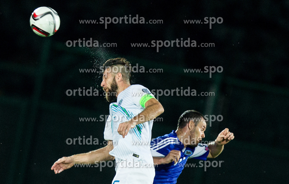 Bostjan Cesar of Slovenia vs Andy Selva of San Marino during football match between National teams of San Marino and Slovenia in Group E of EURO 2016 Qualifications, on October 12, 2015 in Stadio Olimpico Serravalle, Republic of San Marino. Photo by Vid Ponikvar / Sportida