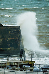 © Licensed to London News Pictures. 02/10/2017. Aberystwyth, Wales, UK.  Gale force winds bring huge waves crashing into the harbour and lighthouse in Aberystwyth , as Storm Brian strikes the UK. Storm Brian, the second named storm of the season, is expected to bring disruptive rain and gale force winds to the west and north of the UK today.Yellow warnings for rain have ben issued by the Met Office. .Photo credit: Keith Morris/LNP