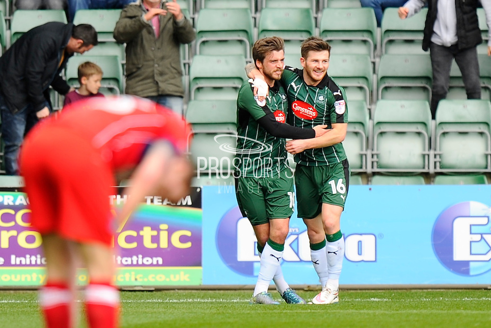 Graham Carey (10) of Plymouth Argyle celebrates scoring a goal to give a 1-0 lead to the home team with Matthew Kennedy (16) of Plymouth Argyle during the EFL Sky Bet League 2 match between Plymouth Argyle and Carlisle United at Home Park, Plymouth, England on 4 March 2017. Photo by Graham Hunt.