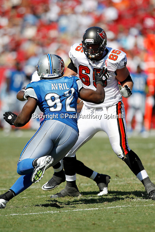 Detroit Lions defensive end Cliff Avril (92) works his way around a block by Tampa Bay Buccaneers offensive tackle Jeremy Trueblood (65) during the NFL week 1 football game against the Tampa Bay Buccaneers on Sunday, September 11, 2011 in Tampa, Florida. The Lions won the game 27-20. ©Paul Anthony Spinelli