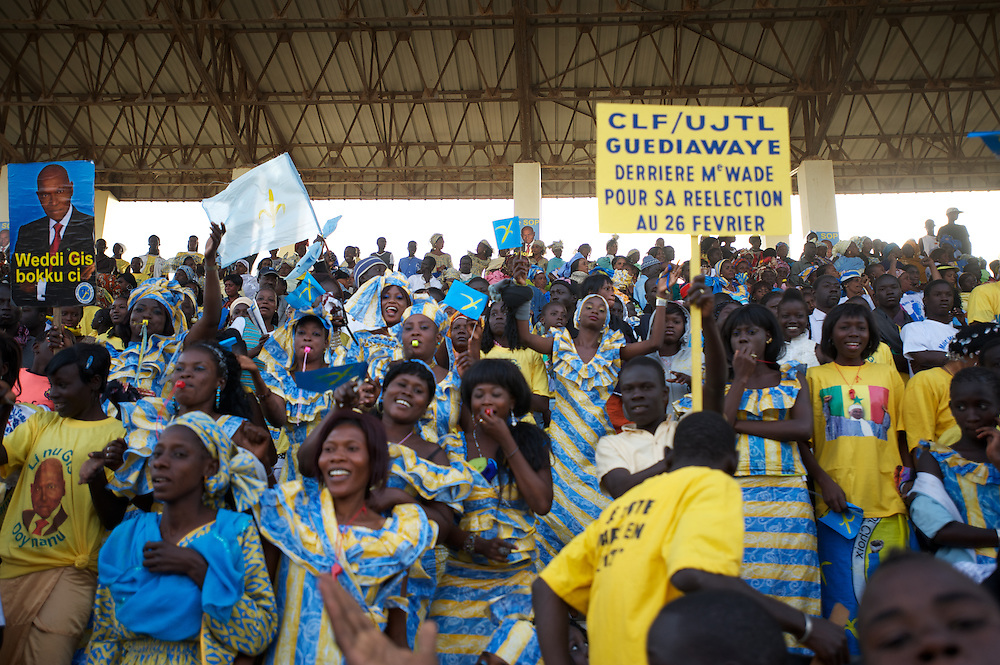 February 22, 2012 - Dakar, Senegal: A group of people react during a campaign rally for president Abdoulaye Wade in Pykine, a suburb of the capital Dakar, ahead of the presidential elections on the 26th of February.  (Paulo Nunes dos Santos/Polaris)