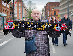 A vendor on Westgate Street selling scarves<br /> <br /> Photographer Simon King/Replay Images<br /> <br /> Guinness PRO14 Round 21 - Dragons v Scarlets - Saturday 28th April 2018 - Principality Stadium - Cardiff<br /> <br /> World Copyright © Replay Images . All rights reserved. info@replayimages.co.uk - http://replayimages.co.uk