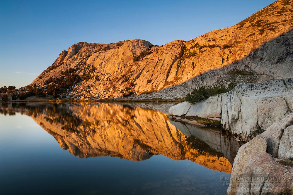 Alpenglow at sunset on Fletcher Peak reflected in Vogelsang Lake; Yosemite National Park; California