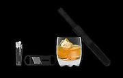 X-ray photography of cigar, cigar cutter, lighter and a glass of whiskey on the rocks