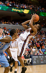 Virginia guard Sean Singletary (44) shoots while falling backwards against UNC.  The Virginia Cavaliers men's basketball team fell to the #3 ranked North Carolina Tar Heels 75-74 at the John Paul Jones Arena in Charlottesville, VA on February 12, 2008.