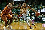 WACO, TX - JANUARY 25: Isaiah Austin #21 of the Baylor Bears drives to the basket against the Texas Longhorns on January 25, 2014 at the Ferrell Center in Waco, Texas.  (Photo by Cooper Neill/Getty Images) *** Local Caption *** Isaiah Austin