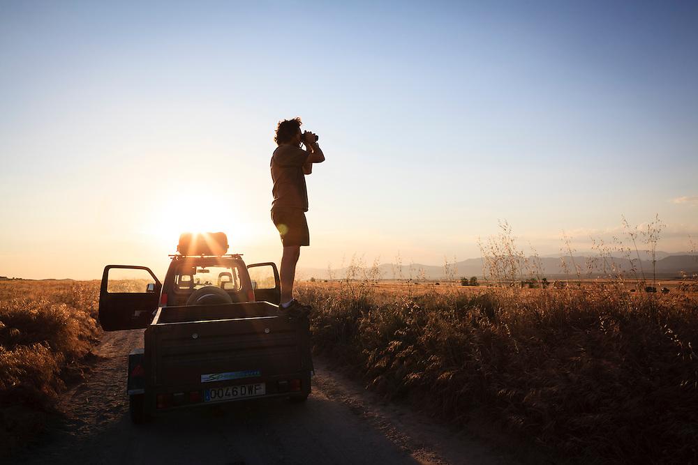 Birdwatcher at sunset. Lleida province. Catalonia. Spain.