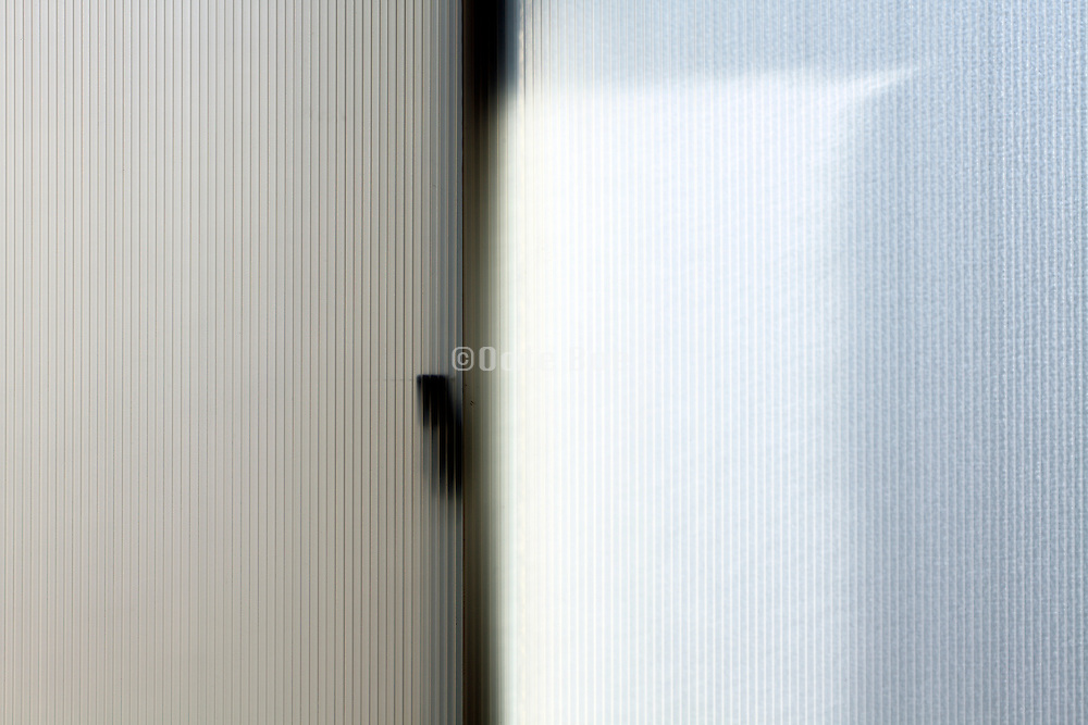 light coming through a window that is covered with a transparent plastic for insulation