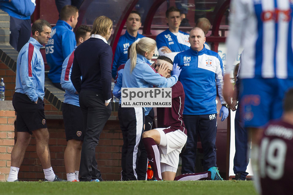 Igor Rossi of Hearts gets treated for a head injury during the Ladbrokes Scottish Premiership match between Heart of Midlothian FC and Kilmarnock FC at Tynecastle Stadium on October 3, 2015 in Edinburgh, Scotland. Photo by Jonathan Faulds/SportPix