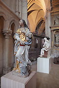 Painted statue of St Margaret, 1633, by Charles Hoyau, originally part of the St Cecilia altar commissioned by canon Bernardin Le Rouge and moved here 1769-1771, in the Chapelle Saint Pierre or St Peter's Chapel in the Cathedrale Saint-Julien du Mans or Cathedral of St Julian of Le Mans, Le Mans, Sarthe, Loire, France. The statue was repainted in the 19th or early 20th century. The cathedral was built from the 6th to the 14th centuries, with both Romanesque and High Gothic elements. It is dedicated to St Julian of Le Mans, the city's first bishop, who established Christianity in the area in the 4th century AD. Picture by Manuel Cohen
