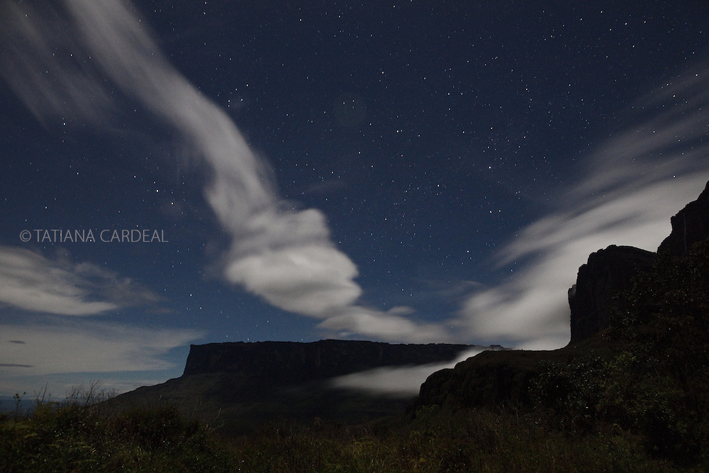 At Roraima Mount base camp, during the second night of the climbing, a dreamy vision of the Kukenan Tepui at night.