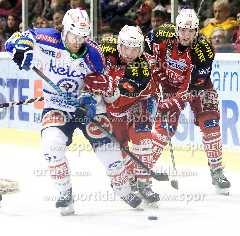 26.12.2013, Stadthalle, Klagenfurt, AUT, EBEL, KAC vs EC VSV, 58. Runde, im Bild Brock McBride (VSV, #10), Markus Pirman (KAC, #44), Patrick Harand (KAC #16) // during the Erste Bank Icehockey League 58th Round match betweeen EC KAC and EC VSV at the City Hall, Klagenfurt, Austria on 2013/12/26. EXPA Pictures © 2013, PhotoCredit: EXPA/ Gert Steinthaler