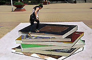 ZHENGZHOU, CHINA - MAY 30: (CHINA OUT) <br /> <br /> 3D Street Paintings In Zhengzhou School<br /> Students pose with a 3D street painting at No.1 Middle School of Zhengzhou on May 30, 2013 in Zhengzhou, Henan Province of China. There are eight paintings in total, and all of them were painted by some Senior One students. <br /> ©ChinaFoto/Exclusivepix