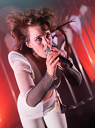 © Licensed to London News Pictures. 30/04/2015. London, UK.   Purity Ring performing live at Shepherds Bush Empire.  In this picture - Megan James.  Purity Ring are a Canadian electronic music duo originally from Edmonton, Alberta formed in 2010.The band consists of Megan James (vocals) and Corin Roddick (instrumentals). Photo credit : Richard Isaac/LNP
