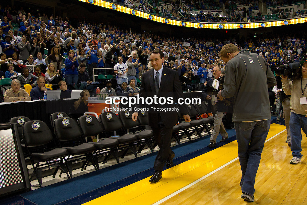 GREENSBORO, NC - DECEMBER 29: Duke Blue Devils head coach Mike Krzyzewski walks across the court after playing the UNC-Greensboro Spartans on December 29, 2010 at the Greensboro Coliseum in Greensboro, North Carolina. Duke won 108-62 and with the win Mike Krzyzewski became the second all-time winningest Division I college basketball coach at 880 wins. (Photo by Peyton Williams/Getty Images) *** Local Caption *** Mike Krzyzewski