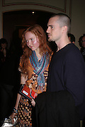 Lily Cole and Alex Daniel, Opening night of Dralion. Cirque de Soleil's 20th anniversary. Royal Albert Hall. 6 jan 2005. ONE TIME USE ONLY - DO NOT ARCHIVE  © Copyright Photograph by Dafydd Jones 66 Stockwell Park Rd. London SW9 0DA Tel 020 7733 0108 www.dafjones.com